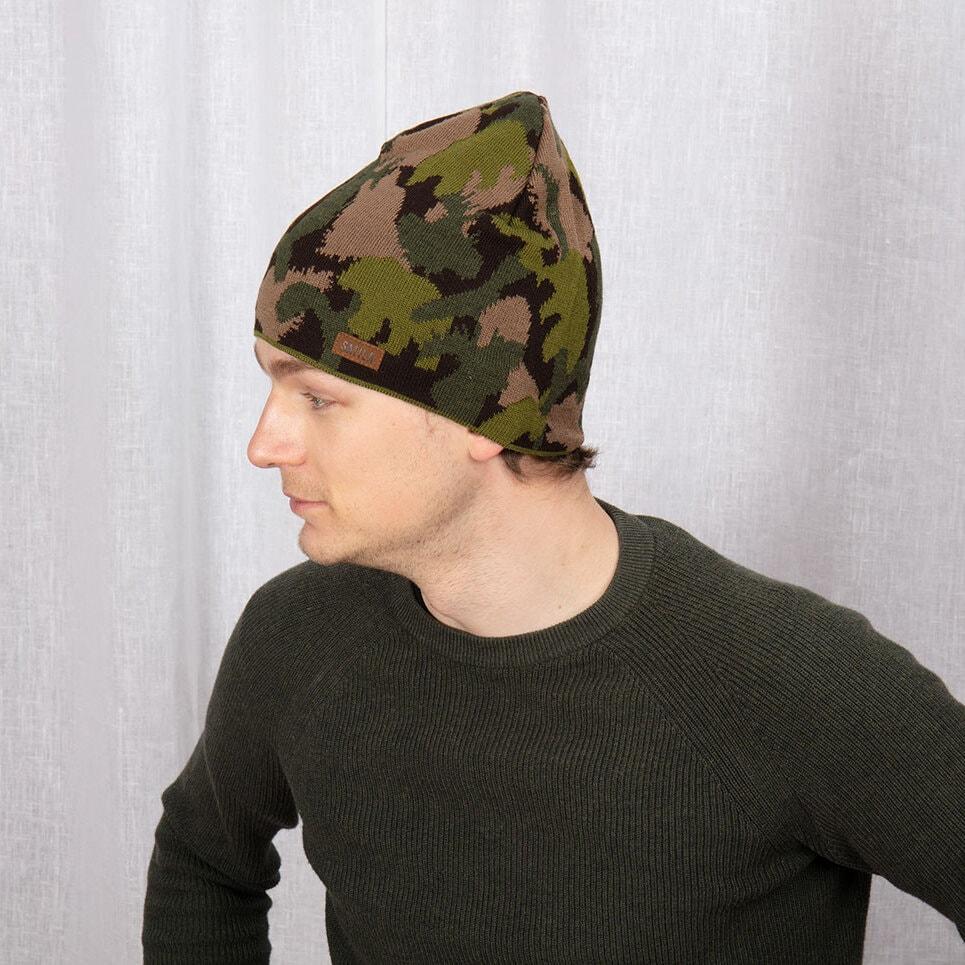 Grön jaktmössa i kamouflage